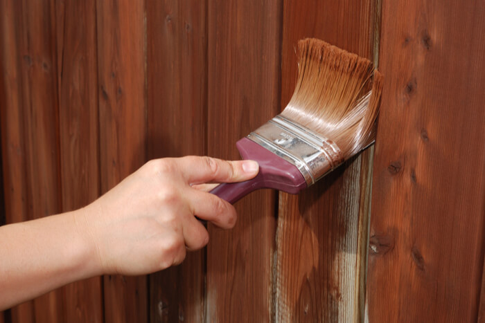 How to maintain a wooden fence for a log cabin