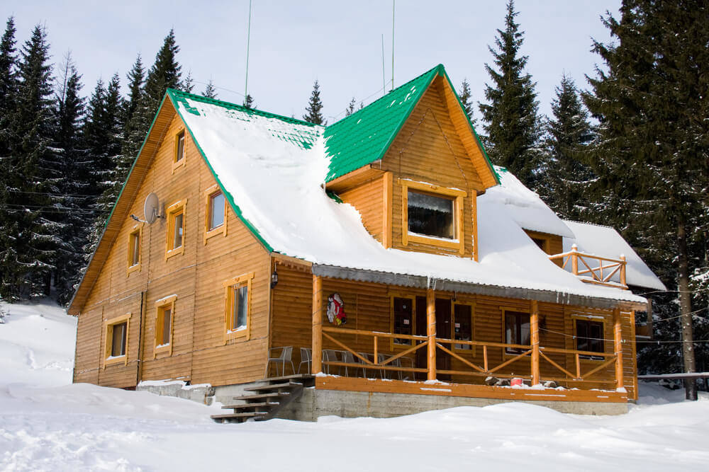 How to clean the snow from the log cabin roof
